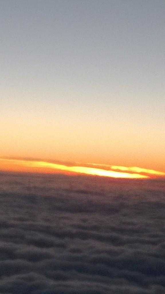 A sea of clouds against a fiery sky. (View from an airplane.)