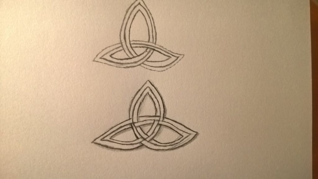 Two pencil-doodle Celtic Trinity Knots