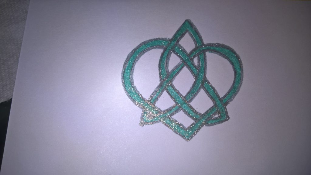 Celtic trinity and heart knot in sparkly green